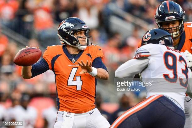 Quarterback Case Keenum of the Denver Broncos passes against the Chicago Bears in the first quarter during an NFL preseason game at Broncos Stadium...