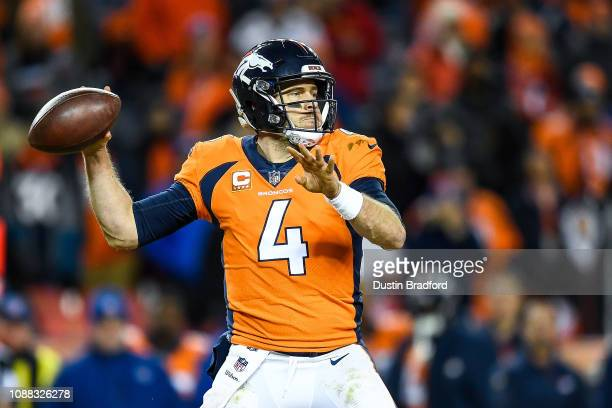 Quarterback Case Keenum of the Denver Broncos passes against the Los Angeles Chargers in the fourth quarter of a game at Broncos Stadium at Mile High...