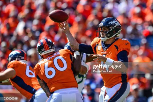 Quarterback Case Keenum of the Denver Broncos passes against the Seattle Seahawks int he first quarter of a game at Broncos Stadium at Mile High on...