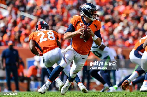 Quarterback Case Keenum of the Denver Broncos rolls out of the pocket against the Seattle Seahawks at Broncos Stadium at Mile High on September 9...