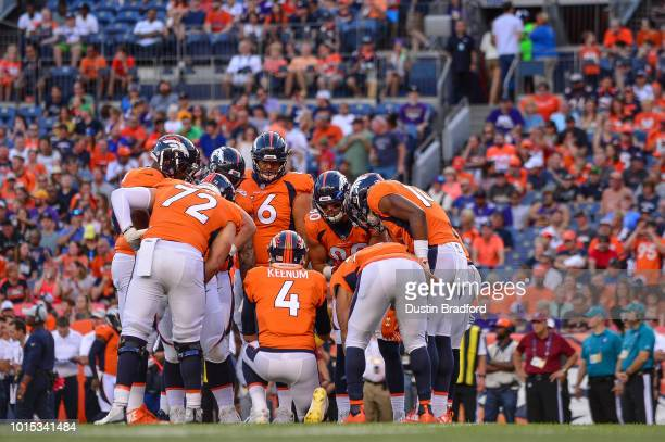 Quarterback Case Keenum of the Denver Broncos runs a huddle in the first quarter during an NFL preseason game at Broncos Stadium at Mile High on...