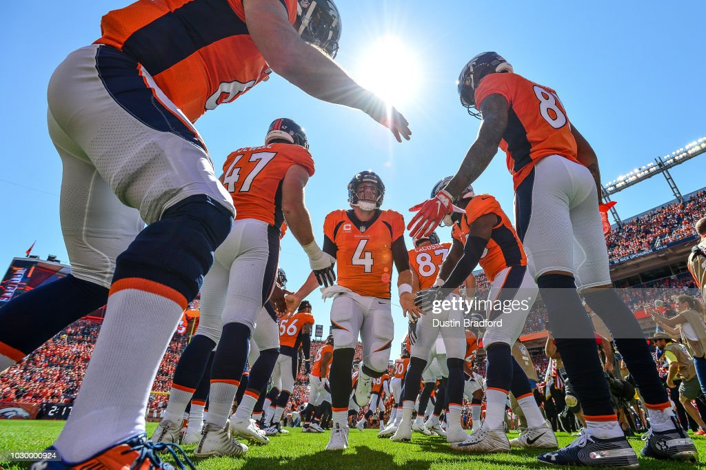 Quarterback Case Keenum #4 of the Denver Broncos runs onto the field during player introductions before a game against the Seattle Seahawks at Broncos Stadium at Mile High on September 9, 2018 in Denver, Colorado.