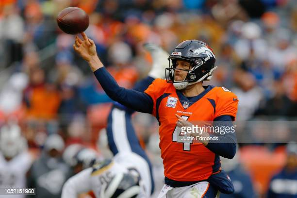 Quarterback Case Keenum of the Denver Broncos throws a pass during the second quarter against the Los Angeles Rams at Broncos Stadium at Mile High on...