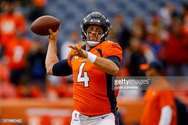 Quarterback Case Keenum of the Denver Broncos throws as he warms hip before a game against the Los Angeles Chargers at Broncos Stadium at Mile High...