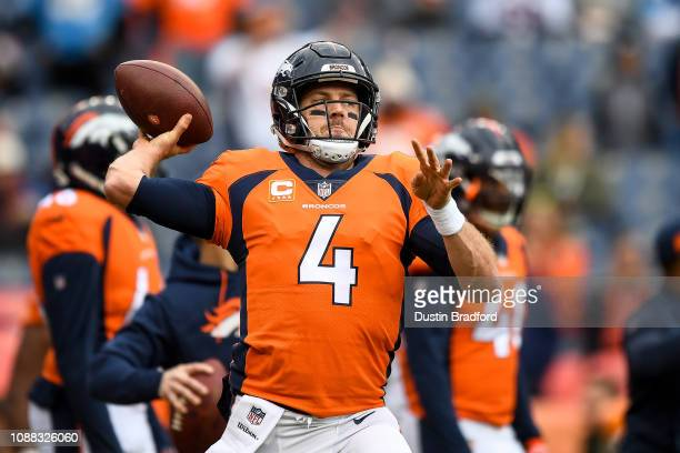 Quarterback Case Keenum of the Denver Broncos throws as he warms up before a game against the Los Angeles Chargers at Broncos Stadium at Mile High on...