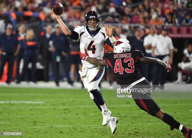Quarterback Case Keenum of the Denver Broncos throws under pressure from linebacker Haason Reddick of the Arizona Cardinals during the second quarter...