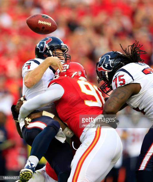 Quarterback Case Keenum of the Houston Texans loses the ball as he is sacked by outside linebacker Tamba Hali of the Kansas City Chiefs as tackle...
