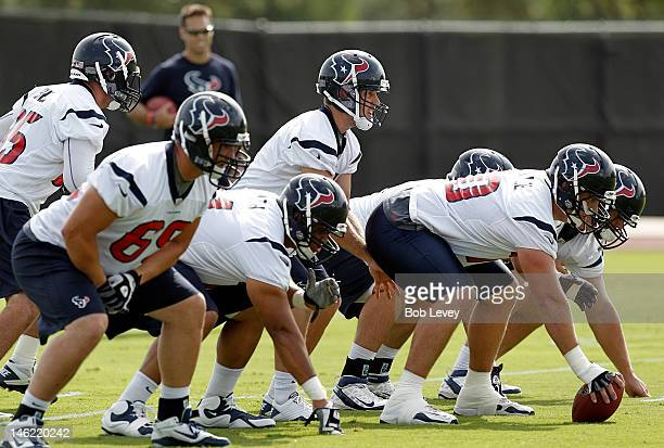 Quarterback Case Keenum of the Houston Texans takes a snap during Houston Texans minicamp at Methodist Training Center on June 12 2012 in Houston...