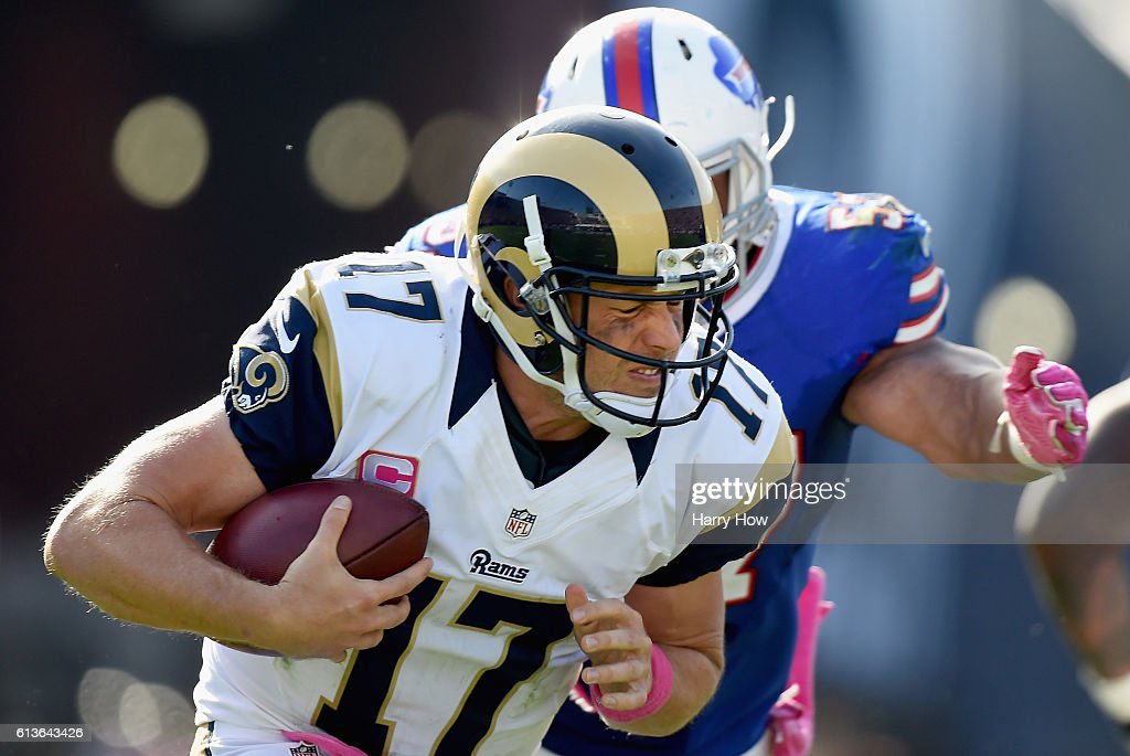 Quarterback Case Keenum #17 of the Los Angeles Rams is sacked by Lorenzo Alexander #57 of the Buffalo Bills for a third down in the third quarter of the game against the Buffalo Bills at the Los Angeles Memorial Coliseum on October 9, 2016 in Los Angeles, California.
