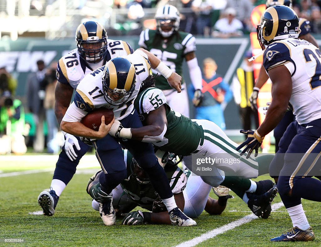 Quarterback Case Keenum #17 of the Los Angeles Rams is sacked by Lorenzo Mauldin #55 of the New York Jets in the second quarter at MetLife Stadium on November 13, 2016 in East Rutherford, New Jersey.