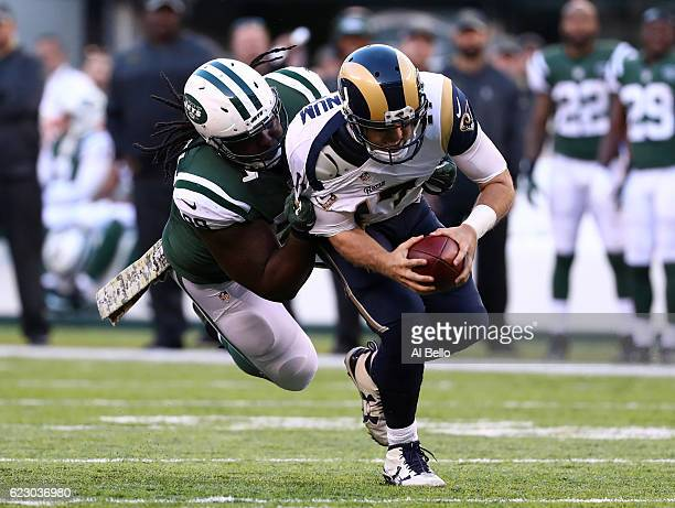Quarterback Case Keenum of the Los Angeles Rams is sacked by Steve McLendon of the New York Jets in the third quarter at MetLife Stadium on November...