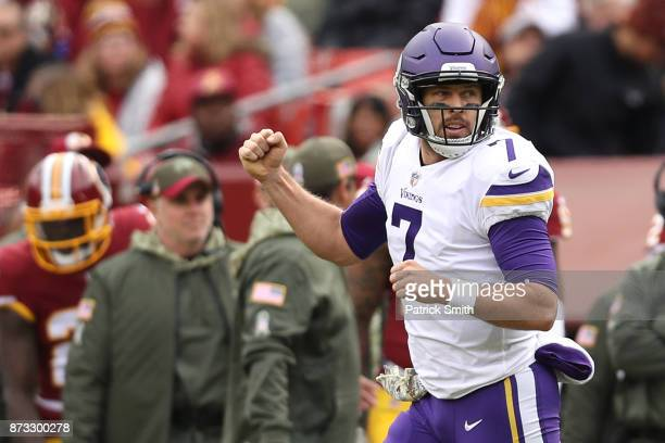 Quarterback Case Keenum of the Minnesota Vikings celebrates after throwing a touchdown during the second quarter against the Washington Redskins at...