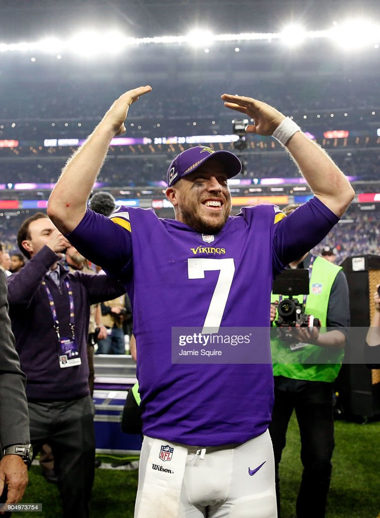 Quarterback Case Keenum #7 of the Minnesota Vikings celebrates as he walks off the field after the Vikings defeated the New Orleans Saints 29-24 to win the NFC divisional round playoff game at U.S. Bank Stadium on January 14, 2018 in Minneapolis, Minnesota.