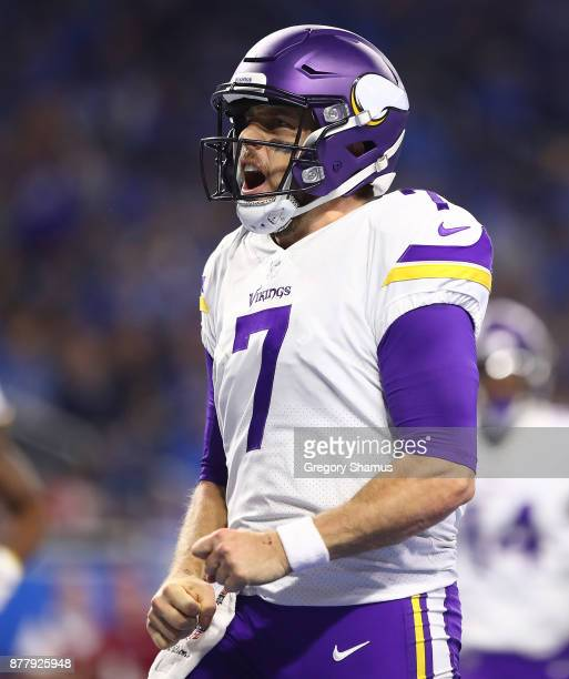 Quarterback Case Keenum of the Minnesota Vikings celebrates hist ouchdownd during the first half at Ford Field on November 23 2017 in Detroit Michigan