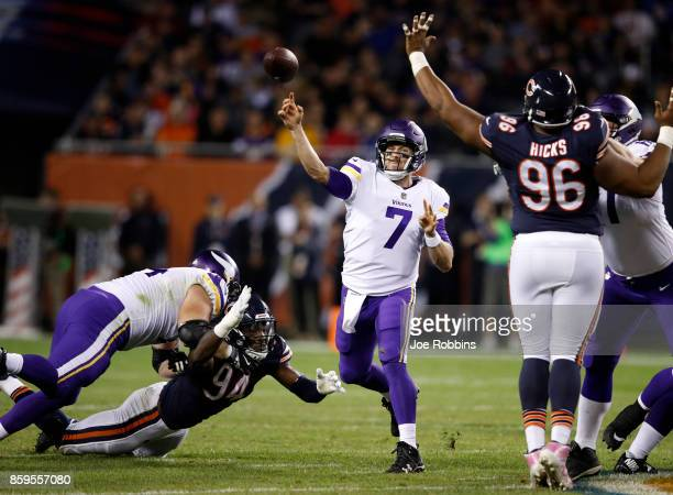 Quarterback Case Keenum of the Minnesota Vikings passes the football in the second quarter against the Chicago Bears at Soldier Field on October 9...
