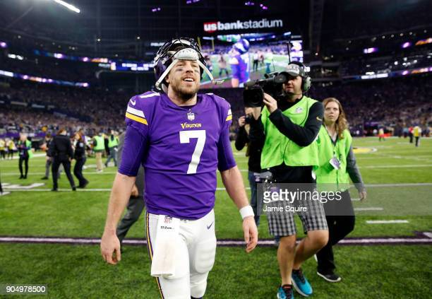 Quarterback Case Keenum of the Minnesota Vikings walks off the field after the Vikings defeated the New Orleans Saints 2924 to win the NFC divisional...
