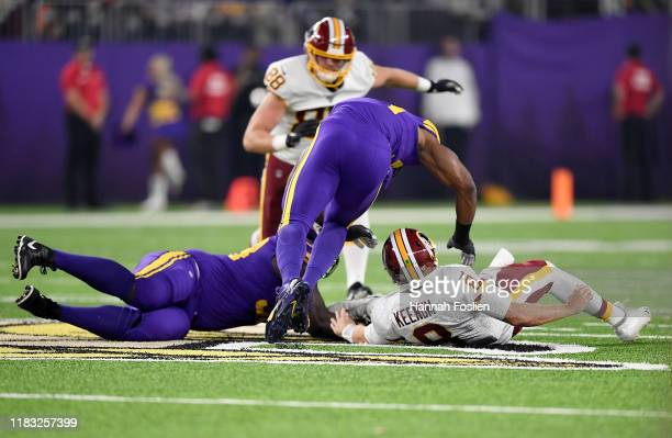 Quarterback Case Keenum of the Washington Redskins fumbles the ball and is recovered by Shamar Stephen of the Minnesota Vikings during the game at US...