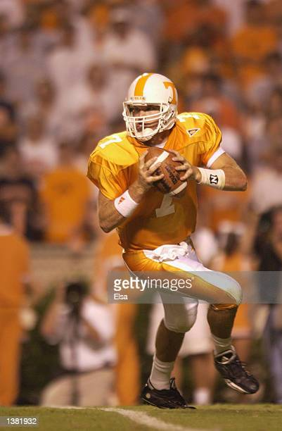 Quarterback Casey Clausen of the Tennessee Volunteers rolls to his left during the NCAA football game against the Middle Tennessee State Blue Raiders...
