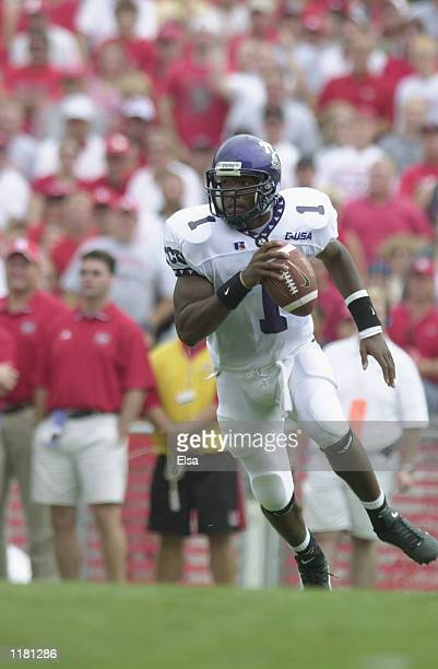 Quarterback Casey Printers of the Texas Christian University Horned Frogs rolls to his left during the NCAA football game against the Nebraska...