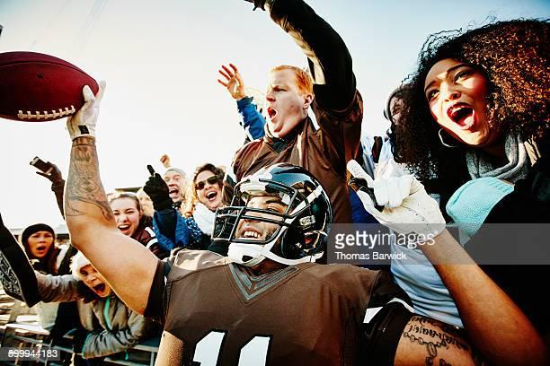 Quarterback celebrating touchdown with fans