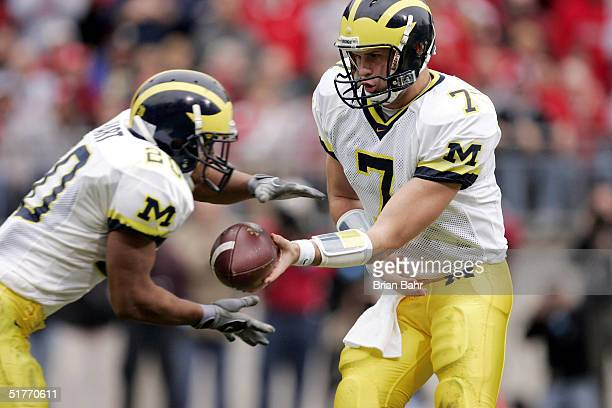 Quarterback Chad Henne of the Michigan Wolverines hands off to running back Mike Hart against the Ohio State Buckeyes during the second quarter on...