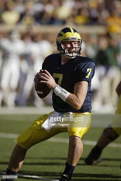 Quarterback Chad Henne of the Michigan Wolverines looks to pass against the Michigan State Spartans during the game on October 30 2004 at Michigan...