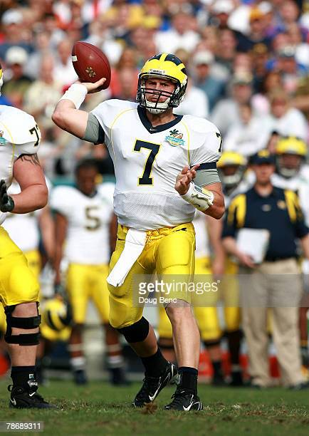 Quarterback Chad Henne of the Michigan Wolverines throws a pass against the Florida Gators in the Capital One Bowl at Florida Citrus Bowl on January...