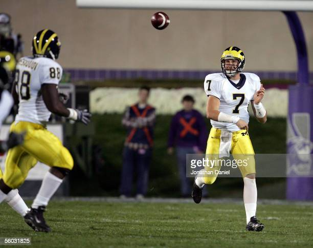 Quarterback Chad Henne of the Michigan Wolverines tosses a short pass to tight end Tim Massaquoi during a game against the Northwestern Wildcats on...