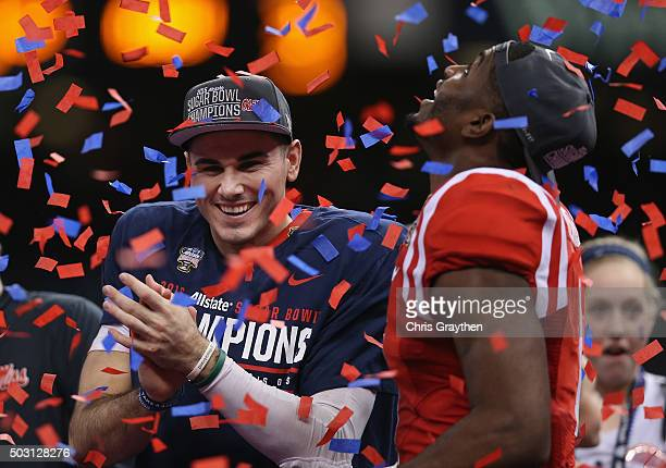 Quarterback Chad Kelly and Laquon Treadwell of the Mississippi Rebels celebrate during the trophy ceremony after their 4820 win over the Oklahoma...