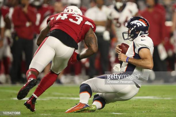 Quarterback Chad Kelly of the Denver Broncos scrambles with the football against linebacker Haason Reddick of the Arizona Cardinals during the...