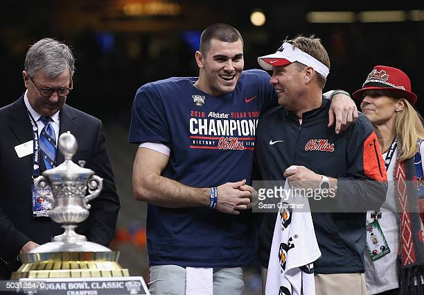 Quarterback Chad Kelly of the Mississippi Rebels and head coach Hugh Freeze celebrate during the trophy ceremony after their 4820 win over the...