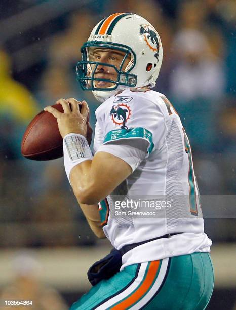 Quarterback Chad Pennington of the Miami Dolphins attempts a pass during the preseason game against the Jacksonville Jaguars at EverBank Field on...