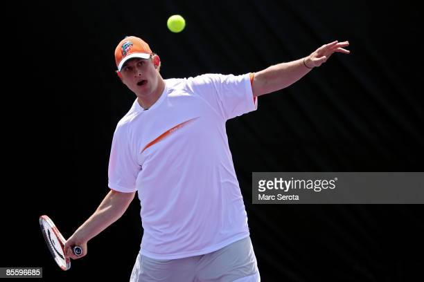 Quarterback Chad Pennington of the Miami Dolphins plays a friendly match against Nadia Petrova during day three of the Sony Ericsson Open at The...