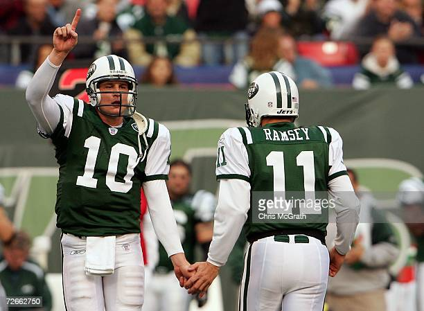 Quarterback Chad Pennington of the New York Jets high fives his backup Patrick Ramsey after coming back into the game against the Houston Texans at...
