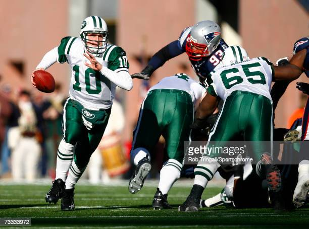 Quarterback Chad Pennington of the New York Jets scrambles against the New England Patriots in the AFC Wild Card Playoff Game at Gillette Stadium on...