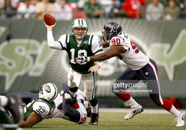 Quarterback Chad Pennington of the New York Jets tries to complete a pass while being pressured by Mario Williams of the Houston Texans at Giants...