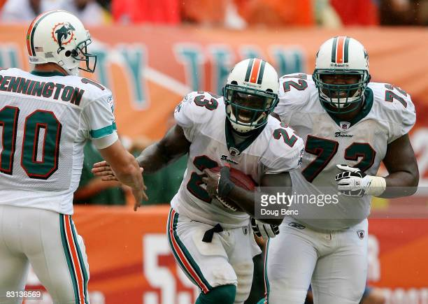 Quarterback Chad Pennington running back Ronnie Brown and offensive lineman Vernon Carey of the Miami Dolphins celebrate after Brown scored a...