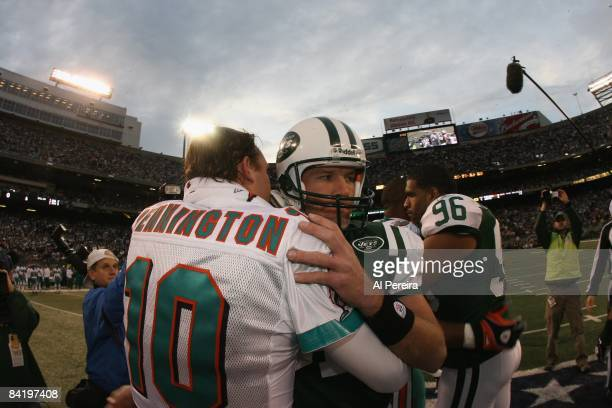 Quarterback Chad Pennington the Miami Dolphins meets with Quarterback Brett Favre of the New York Jets on December 28, 2008 at Giants Stadium, East...