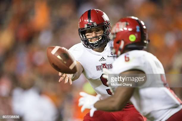 Quarterback Chad Voytik of the Arkansas State Red Wolves pitches the ball to running back Warren Wand of the Arkansas State Red Wolves during their...