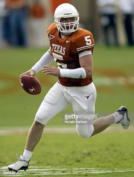 Quarterback Chance Mock of the Texas Longhorns scrambles with the ball against the Nebraska Cornhuskers at Texas Memorial Stadium on November 1, 2003...