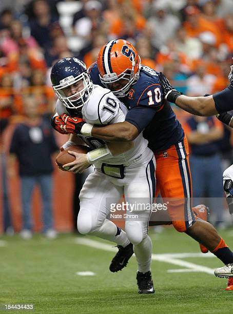 Quarterback Chandler Whitmer of the Connecticut Huskies is sacked by Markus Pierce-Brewster of the Syracuse Orange during the game on October 19,...