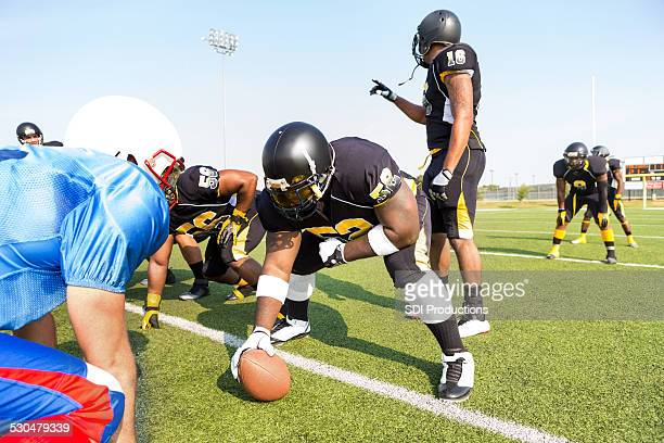 Quarterback changing play at line of scrimmage during football game
