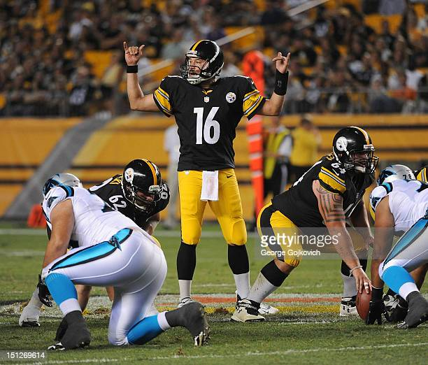 Quarterback Charlie Batch of the Pittsburgh Steelers signals at the line of scrimmage as he stands behind offensive linemen John Malecki and Doug...