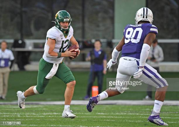 Quarterback Charlie Brewer of the Baylor Bears runs up field against defensive end Bronson Massie of the Kansas State Wildcats during the second half...