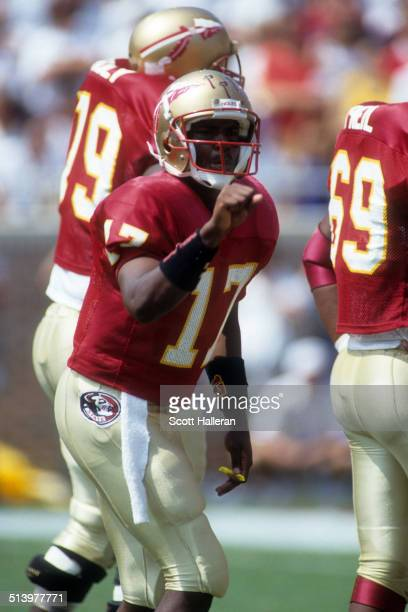 Quarterback Charlie Ward of the Florida State Seminoles calls out the play during an NCAA game against the Clemson Tigers on September 11 1993 at...