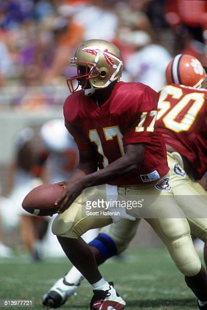 Quarterback Charlie Ward of the Florida State Seminoles looks to hand off the ball during an NCAA game against the Clemson Tigers on September 11...