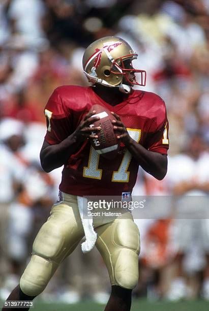 Quarterback Charlie Ward of the Florida State Seminoles readies to throw the ball during an NCAA game against the Clemson Tigers on September 11 1993...