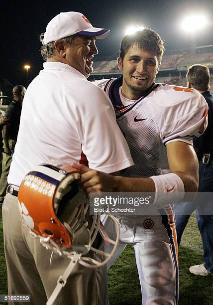 Quarterback Charlie Whitehurst of the Clemson Tigers gets a hug from Assistant Head Coach Brad Scott after defeating the University of Miami 24-17 on...