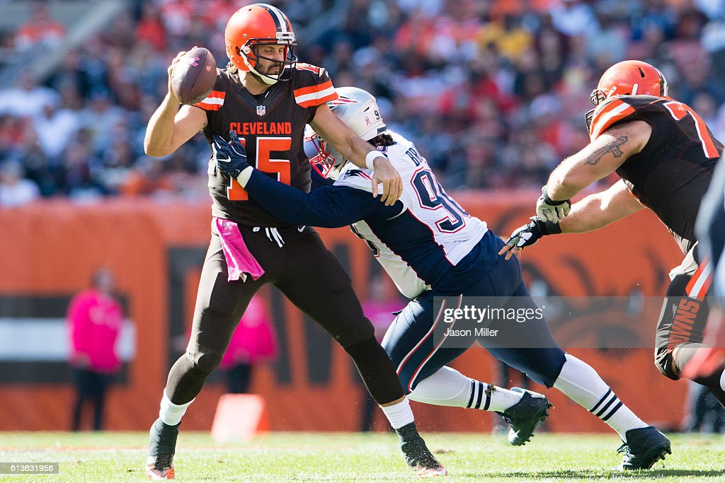 Quarterback Charlie Whitehurst #15 of the Cleveland Browns is sacked by defensive tackle Malcom Brown #90 of the New England Patriots at FirstEnergy Stadium on October 9, 2016 in Cleveland, Ohio. The Patriots defeated the Browns 33-13.