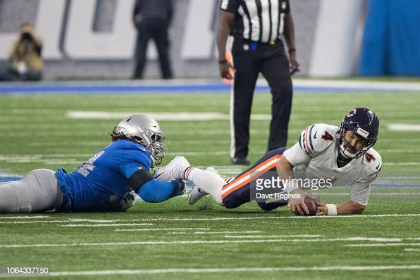 Quarterback Chase Daniel of the Chicago Bears is sacked by Ezekiel Ansah of the Detroit Lions during an NFL game at Ford Field on November 22 2018 in...